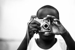 Hands on point and shoot camera. Boy taking a photograph with a point and shoot camera Royalty Free Stock Photography