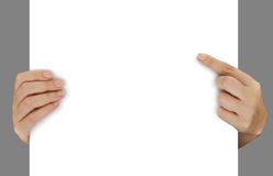 Hands pointing on blank white paper Royalty Free Stock Photography