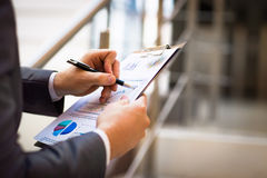Hands pointing at business document while discussing it Stock Photo