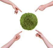 Hands pointing at green planet Stock Image