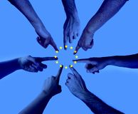 Hands pointing on the same spot with an layered european union flag - agreement Elections to the European Parliament. Hands pointing on the same spot with an royalty free stock photography