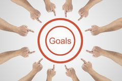 Hands pointing to word - goals.Goals achievement concept on white background stock images