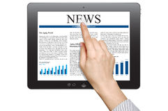Hands are pointing on touch screen device. Female hands are pointing on touch screen device with business news Stock Photo