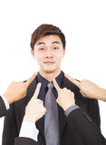 Hands pointing towards businessman Stock Photography