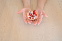 Hands and pomegranate Stock Photos
