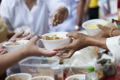 Hands of the poor receive food from the donor`s share. poverty concept. The hands of the poor donate food. Concept of famine royalty free stock images