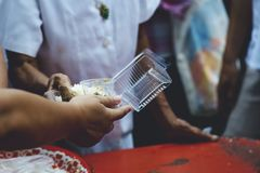 Hands of the poor receive food from the donor`s share. poverty concept.  stock images