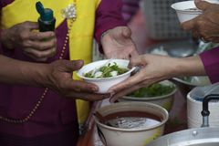 Hands of the poor receive food from the donor`s share. poverty concept. Food for the poor and homeless Help concept stock photo