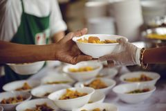 Hands of the poor receive food from the donor`s share. poverty concept. The hands of the rich give food to the hands of the poor. Concept: The concept of sharing royalty free stock photo