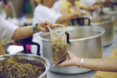 The hands of the poor receive food from the hands of the humane : the concept of relief.  royalty free stock image