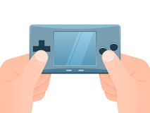 Hands with portable games console. Hands holding portable games console Royalty Free Stock Photography