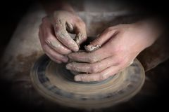 Hands of a potter Royalty Free Stock Image