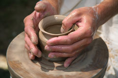 Hands of the potter Royalty Free Stock Image
