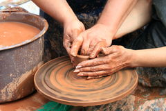 Hands of a potter. Closeup Royalty Free Stock Image