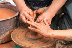 Hands of a potter. Close-up Royalty Free Stock Image