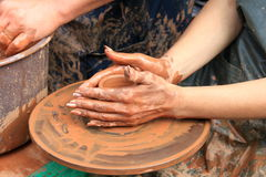Hands of a potter. Close-up Stock Photography