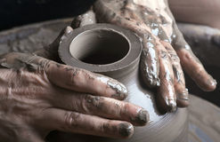 Hands of a potter. Creating an earthen jar on the circle Royalty Free Stock Photography