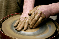 Hands of the potter Stock Images