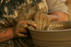 Hands of potter in clay Royalty Free Stock Photo