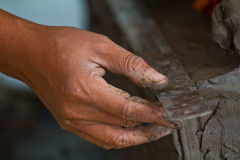 Hands of potter in clay Stock Image