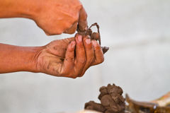 Hands of potter in clay Royalty Free Stock Image