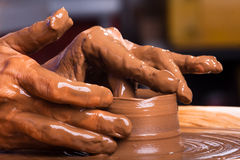 Hands of a potter, creating a clay jug Stock Photography