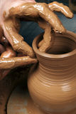 Hands of a potter, creating an earthen jar Royalty Free Stock Images
