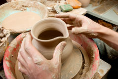 Hands of a potter, creating an earthen jar Stock Images