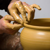 Hands of a potter Stock Photo