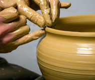 Hands of a potter Stock Photography