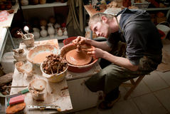 Hands of a potter, creating an earthen jar on the circle Stock Photos