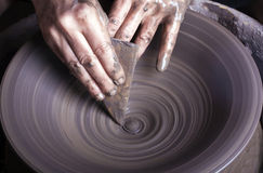 Hands of a potter Stock Images