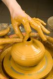 Hands of a potter Stock Photos
