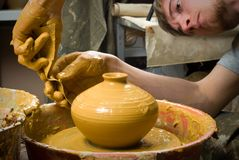 Hands of a potter, creating an earthen jar Royalty Free Stock Photos