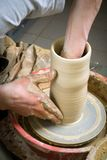 Hands of a potter, creating an earthen jar Stock Photos