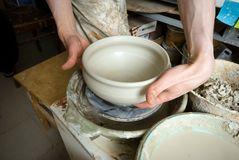 Hands of a potter, creating an earthen jar Stock Photo