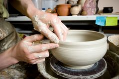 Hands of a potter, creating an earthen jar Stock Photography