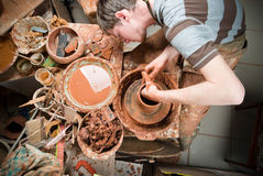 Hands of a potter, creating an earthen jar Royalty Free Stock Photo