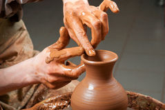 Hands of a potter, creating an earthen jar Stock Photography