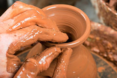 Hands of a potter, creating an earthen jar Royalty Free Stock Photography