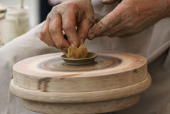 Hands of a potter, creating an earthen jar on the circle Royalty Free Stock Photo
