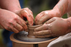 Hands of a potter, Stock Images