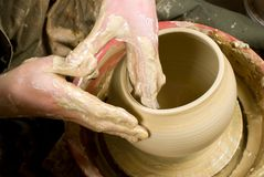 Hands of a potter, creating an earthen jar Stock Image