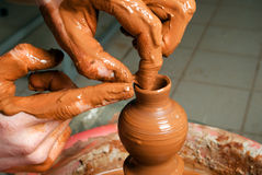 Hands of a potter, creating an little earthen jar Royalty Free Stock Images