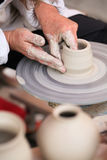 Hands of a potter creating Stock Image