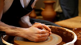 Hands of the potter stock video