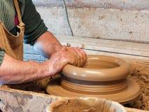 Hands of a Potter make a big pot stock photo