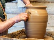 Hands of a Potter make a big pot royalty free stock photo