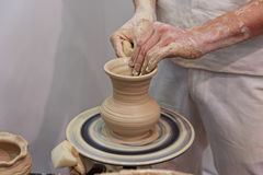 Hands of a potter making jug Royalty Free Stock Images