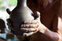Hands of a potter manufactures clay pot Royalty Free Stock Images